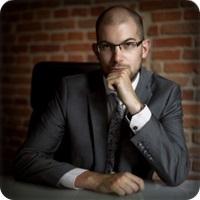 Michal Gawlak immigration expert Poland
